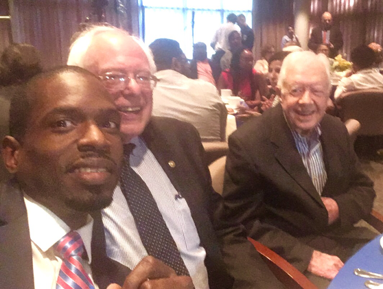 South Fulton City Councilman khalid with Senator Bernie Sanders & President Jimmy Carter at Carter Center's Human Rights Forum